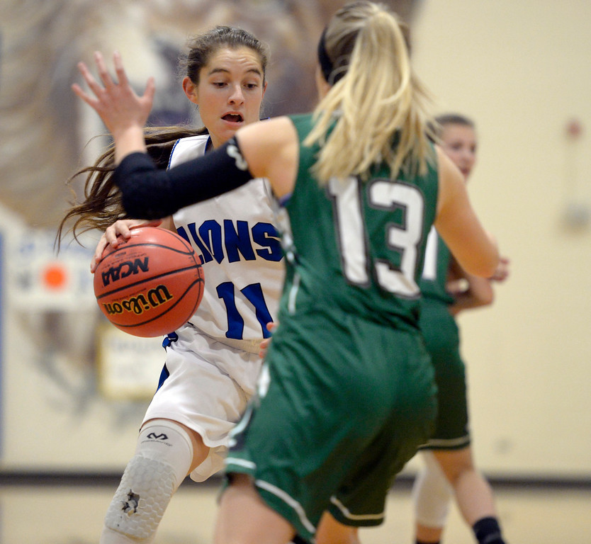 . LYONS, CO - JANUARY 10: Lion Jazmyn Enny moves the ball in front of Eagle Sarah Collins in the first quarter January 10, 2019 at Lyons Middle/Senior High School. To view more photos visit bocopreps.com. (Photo by Lewis Geyer/Staff Photographer)