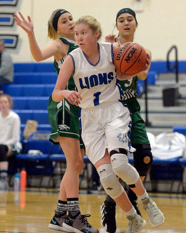 . LYONS, CO - JANUARY 10: Lion Kylee Udovich drives past Eagles Sarah Collins and Kali Siemers in the first quarter January 10, 2019 at Lyons Middle/Senior High School. To view more photos visit bocopreps.com. (Photo by Lewis Geyer/Staff Photographer)
