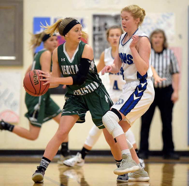 . LYONS, CO - JANUARY 10: Lion Kylee Udovich covers Eagle Sarah Collins in the first quarter January 10, 2019 at Lyons Middle/Senior High School. To view more photos visit bocopreps.com. (Photo by Lewis Geyer/Staff Photographer)