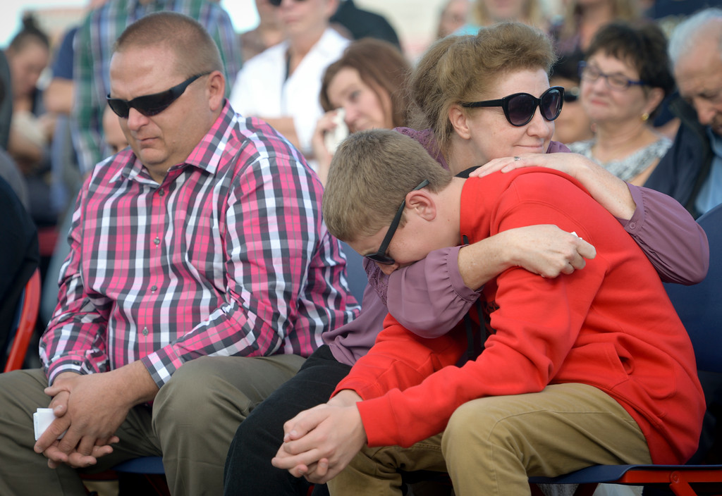 . With Makayla Grote\'s father Troy Grote sitting next to them, her mother Dennette Grote embraces their son Justin during Makayla\'s memorial service at Colorado National Speedway Sunday afternoon. To view more photos and a video visit timescall.com. Lewis Geyer/Staff Photographer Nov. 26, 2017