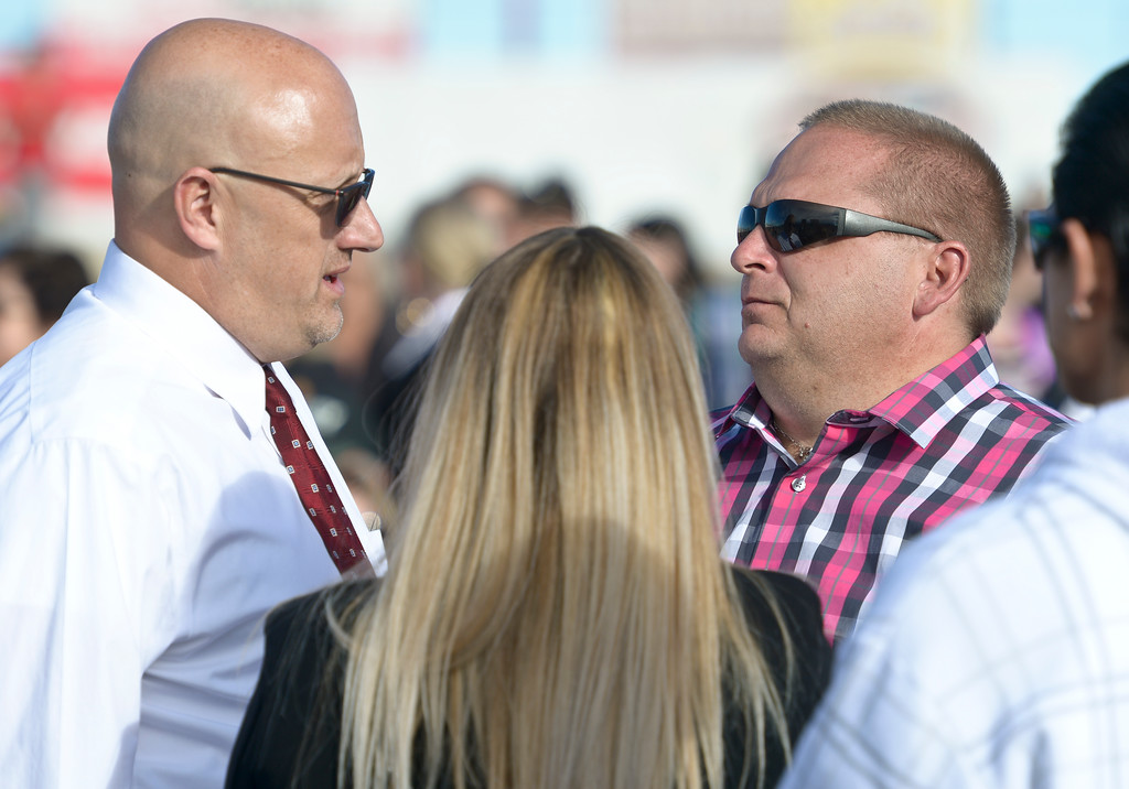 . Longmont Police detective Stephen Desmond, left, talks with Makayla Grote\'s father Troyy Grote before the service for Makayla\'s memorial service at Colorado National Speedway Sunday afternoon. To view more photos and a video visit timescall.com. Lewis Geyer/Staff Photographer Nov. 26, 2017