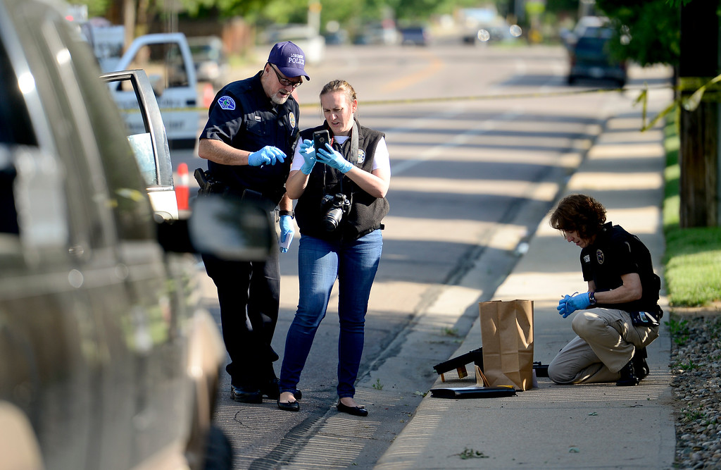 . Longmont Police and evidence technicians are seen on Lashley Street near 6th Avenue in Longmont, Colorado on June 6, 2018. Police are investigating an early morning shooting.  (Photo by Matthew Jonas/Staff Photographer)