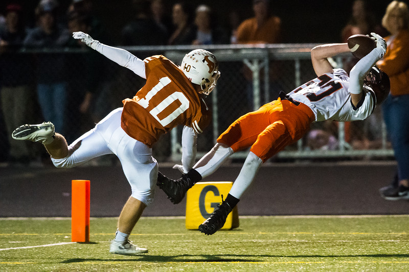 """Erie's Quintin Hyrup catches the ball in the end zone resulting in a touch down during the game against Mead at Mead High School on Friday. <br /> More photos:  <a href=""""http://www.BoCoPreps.com"""">http://www.BoCoPreps.com</a><br /> (Autumn Parry/Staff Photographer)<br /> October 28, 2016"""