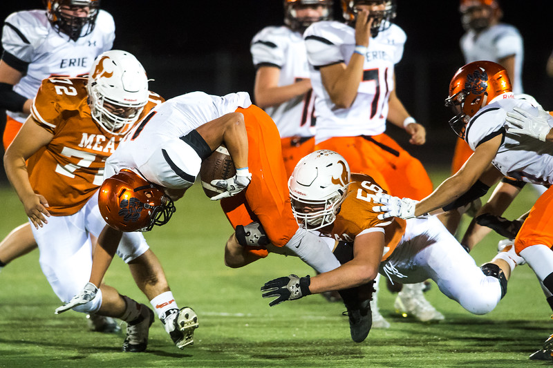 "Erie's running back Noah Roper is tackled by Mead's defense during the game at Mead High School on Friday. <br /> More photos:  <a href=""http://www.BoCoPreps.com"">http://www.BoCoPreps.com</a><br /> (Autumn Parry/Staff Photographer)<br /> October 28, 2016"
