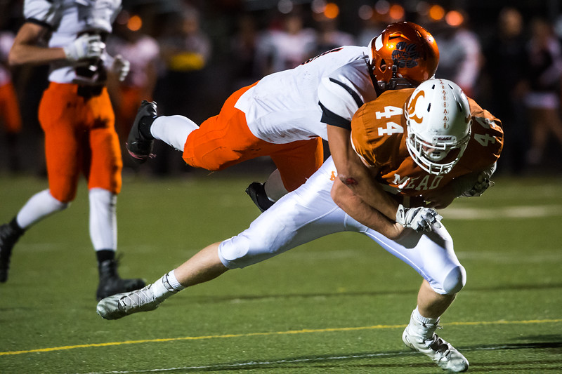 "Erie's Noah Roper tackles Mead's Derrick Edwards during the game at Mead High School on Friday. <br /> More photos:  <a href=""http://www.BoCoPreps.com"">http://www.BoCoPreps.com</a><br /> (Autumn Parry/Staff Photographer)<br /> October 28, 2016"