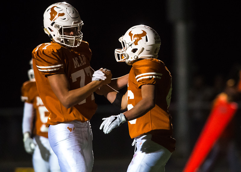 "Mead's Nathan Mackey (right) is congratulated by Tristan Lee after scoring a touchdown during the game against Erie at Mead High School on Friday.  <br /> More photos:  <a href=""http://www.BoCoPreps.com"">http://www.BoCoPreps.com</a><br /> (Autumn Parry/Staff Photographer)<br /> October 28, 2016"