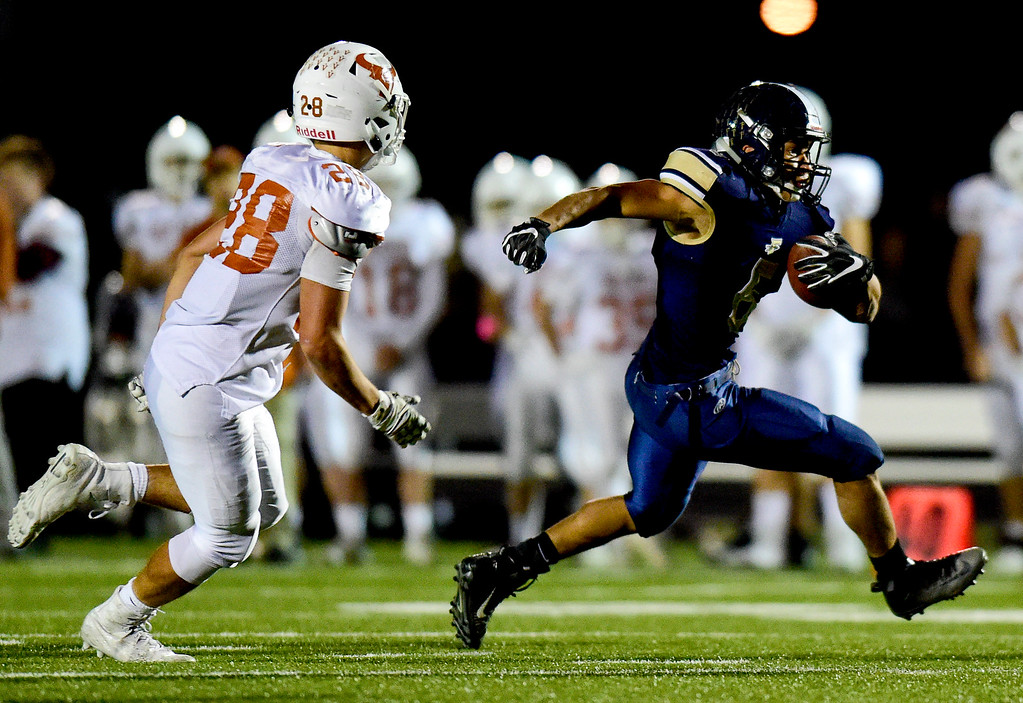 . Frederick High School\'s James Jones (No. 6) sprints away from Mead High School\'s Evan Hansen (No. 28) in Frederick, Colorado on Oct. 12, 2017. (Photo by Matthew Jonas/Times-Call)