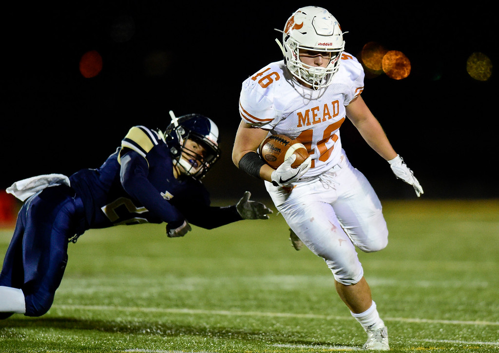 . Mead High School\'s Nathan Mackey (No. 46) runs the ball in the game against Frederick High School in Frederick, Colorado on Oct. 12, 2017. (Photo by Matthew Jonas/Times-Call)