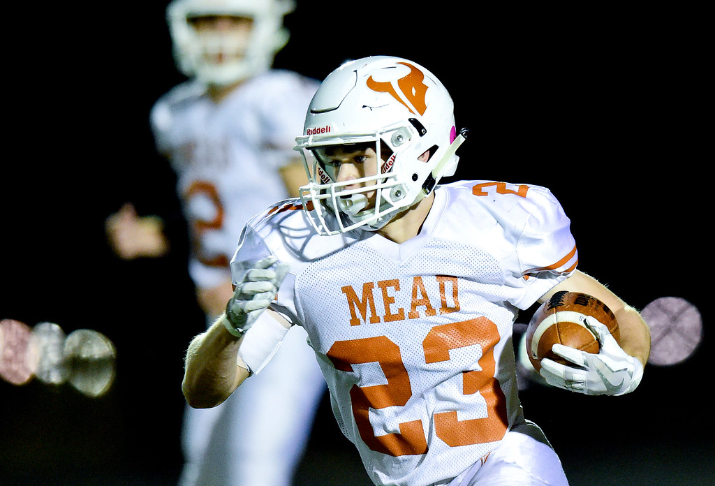 . Mead High School\'s Jake Wachter (No. 23) runs the ball against Frederick High School in Frederick, Colorado on Oct. 12, 2017. (Photo by Matthew Jonas/Times-Call)