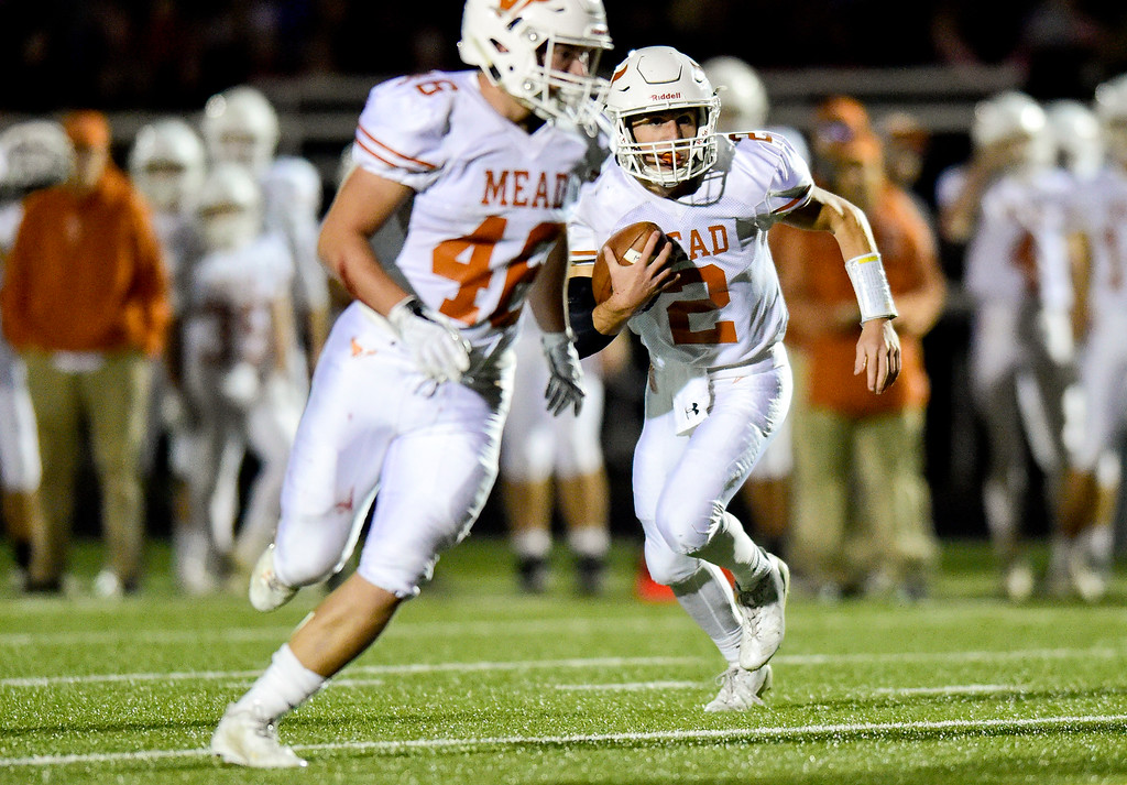 . Mead High School\'s (No. 2) Tyler Keys runs the ball in the game against Frederick High School in Frederick, Colorado on Oct. 12, 2017. (Photo by Matthew Jonas/Times-Call)
