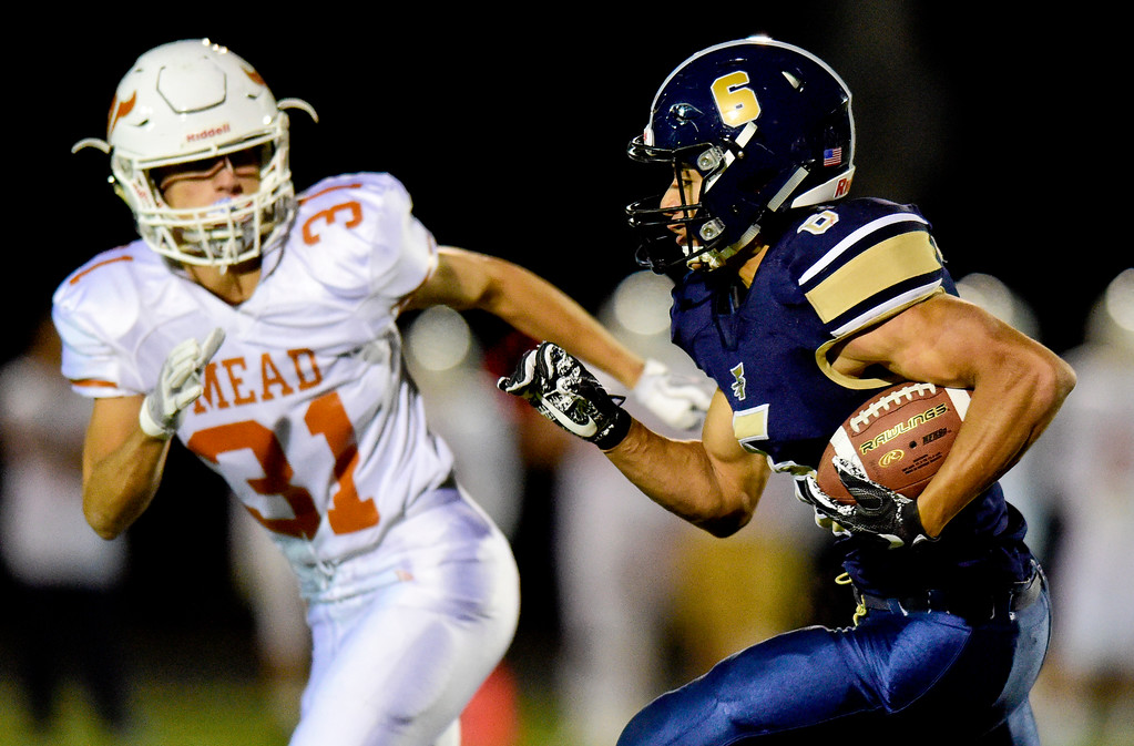 . Frederick High School\'s James Jones (No. 6) is chased by Mead High School\'s Trace Lindemann (No. 31) in Frederick, Colorado on Oct. 12, 2017. (Photo by Matthew Jonas/Times-Call)
