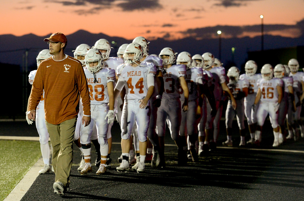 . Mead High School walks to the field before their game against Frederick High School in Frederick, Colorado on Oct. 12, 2017. (Photo by Matthew Jonas/Times-Call)