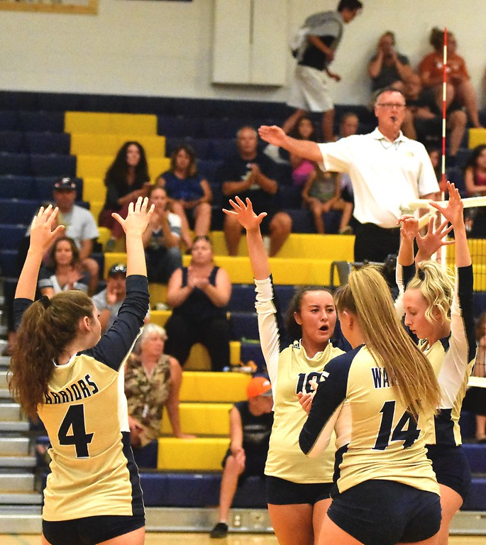 . The Frederick volleyball team celebrates a kill against mead during the teams\' match on Tuesday, Sept. 11, at Frederick High School.