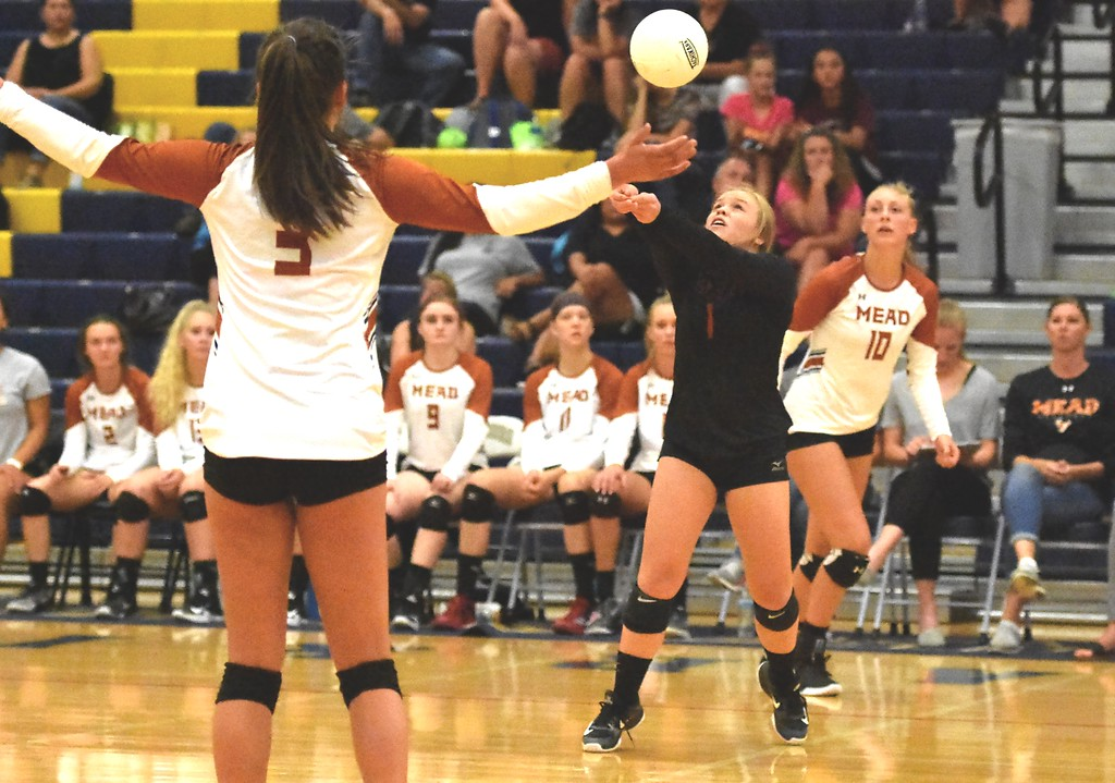 . Mead\'s Hope Borger passes against Frederick during the teams\' match on Tuesday, Sept. 11, at Frederick High School.