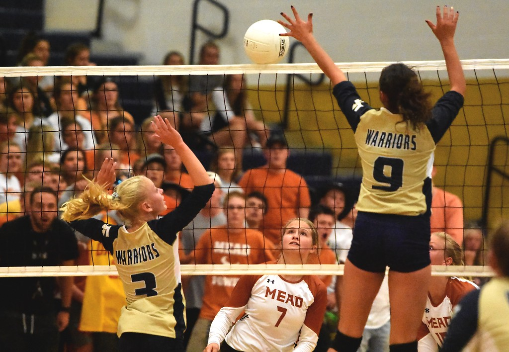 . The Mead and Frederick volleyball players watch a ball sit on the net during the teams\' match on Tuesday, Sept. 11, at Frederick High School.