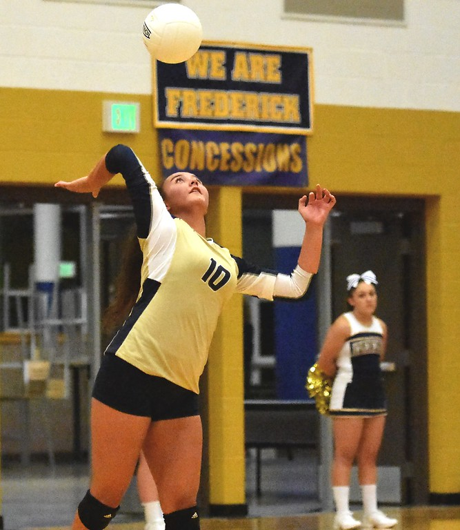 . Frederick\'s Leilani Purcell serves against Mead during the teams\' match on Tuesday, Sept. 11, at Frederick High School.