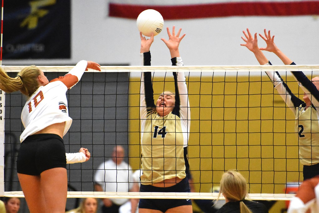 . Frederick\'s Gillian Ridgley goes up for a block against Mead during the teams\' match on Tuesday, Sept. 11, at Frederick High School.