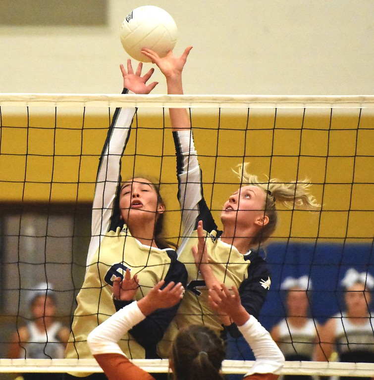 . Fredrick\'s Kendal Rivera and Bailey Baumgardner tip a Mead hit during the teams\' match on Tuesday, Sept. 11, at Frederick High School.