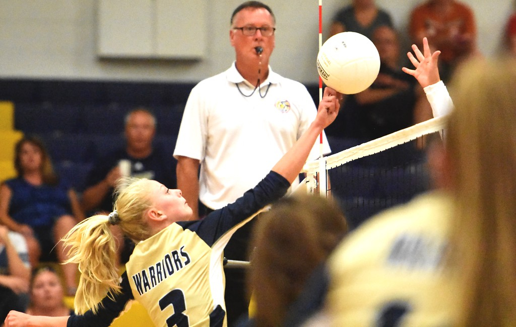 . Frederick\'s Kinley Lindhardt hits against Mead during the teams\' match on Tuesday, Sept. 11, at Frederick High School.