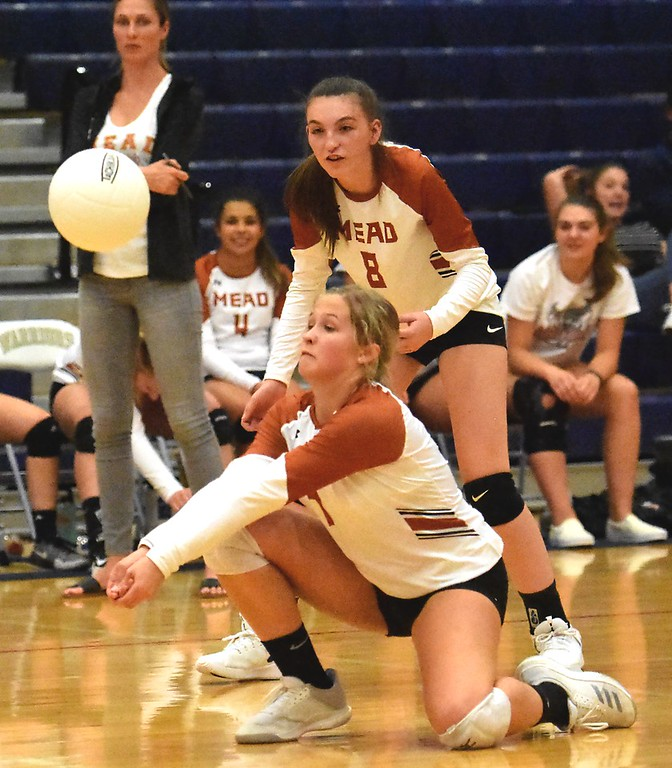 . Mead\'s Lauren Steidl digs a Frederick hit during the teams\' match on Tuesday, Sept. 11, at Frederick High School.