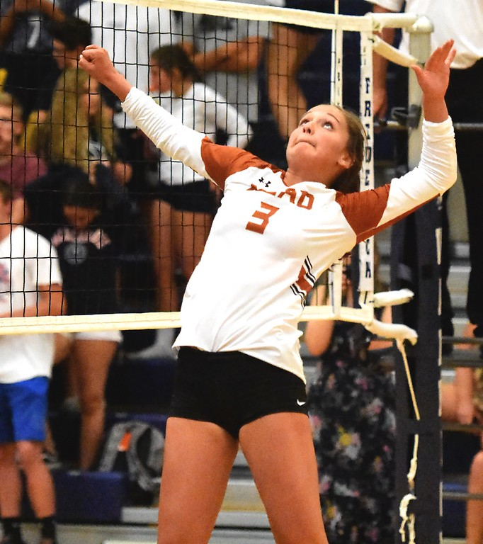 . Mead\'s Emily Stewart goes up for a hit against Frederick during the teams\' match on Tuesday, Sept. 11, at Frederick High School.