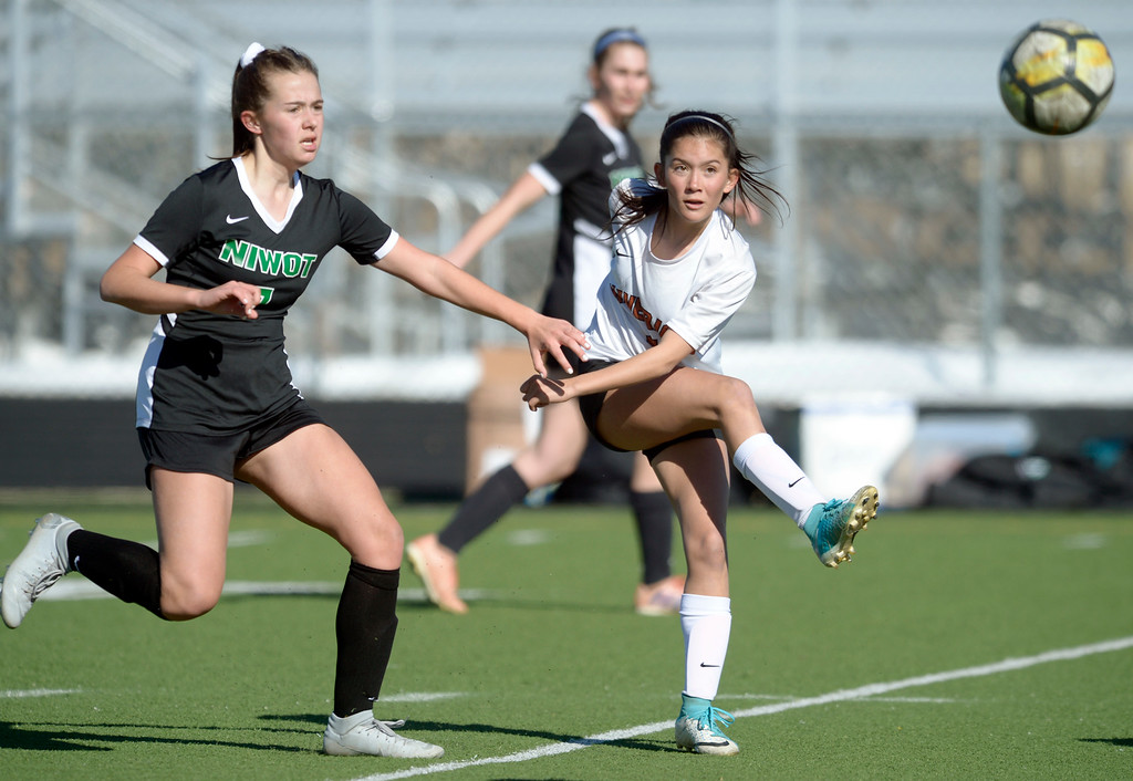 . MEAD, CO - MARCH 15: Mead\'s Cora Thorndike kicks the ball away from Niwot\'s Ava Dumler in the first half at Mead High School March 15, 2019. To view more photos visit bocopreps.com. (Photo by Lewis Geyer/Staff Photographer)