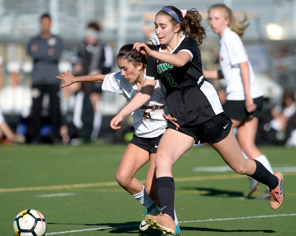 . MEAD, CO - MARCH 15: Mead\'s Cora Thorndike and Niwot\'s Natalia Storz battle for the ball in the first half at Mead High School March 15, 2019. To view more photos visit bocopreps.com. (Photo by Lewis Geyer/Staff Photographer)