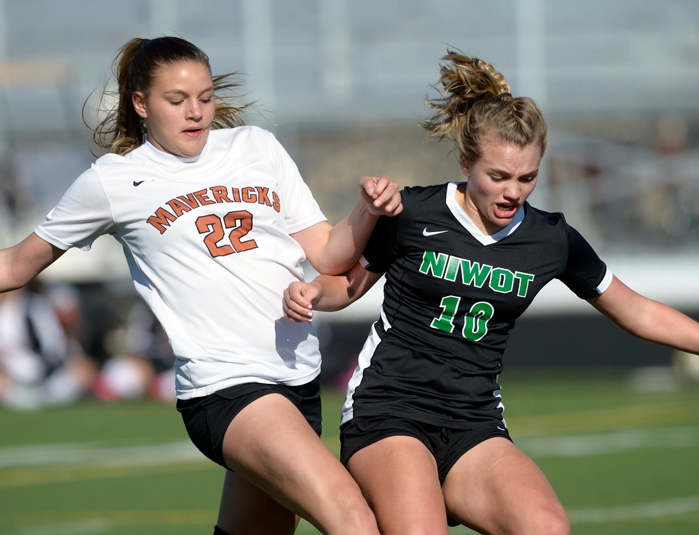 . MEAD, CO - MARCH 15: Mead\'s Riley Gilbert and Niwot\'s Maddie Borncamp battle for the ball in the first half at Mead High School March 15, 2019. To view more photos visit bocopreps.com. (Photo by Lewis Geyer/Staff Photographer)