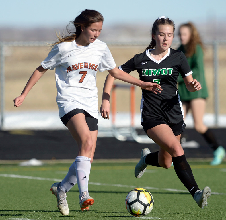 . MEAD, CO - MARCH 15: Mead\'s Haley Williams moves the ball next to Niwot\'s Ava Dumler in the first half at Mead High School March 15, 2019. To view more photos visit bocopreps.com. (Photo by Lewis Geyer/Staff Photographer)