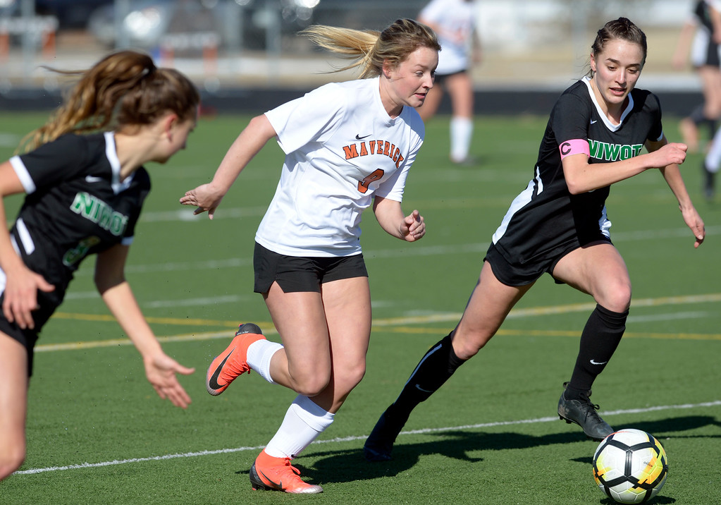 . MEAD, CO - MARCH 15: Mead\'s Peyton Fox moves the ball between Niwot\'s Lauren Cranny and Elise Crall in the first half at Mead High School March 15, 2019. To view more photos visit bocopreps.com. (Photo by Lewis Geyer/Staff Photographer)