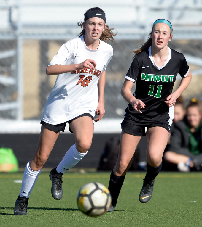 . MEAD, CO - MARCH 15: Mead\'s Brooke Davis passes the ball away from Niwot\'s Kayla Osegueda in the first half at Mead High School March 15, 2019. To view more photos visit bocopreps.com. (Photo by Lewis Geyer/Staff Photographer)