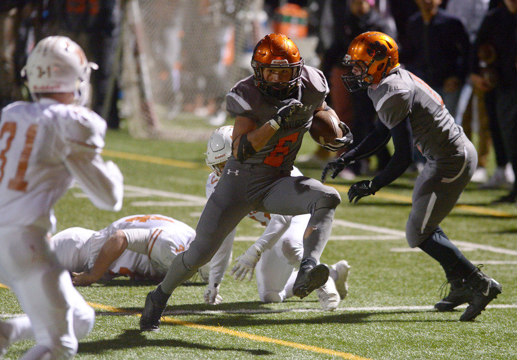 . Erie\'s Noah Roper runs in for a fourth quarter touchdown against in the Mead Friday night at Erie High School. Mead won 42-28. To view more photos visit bocopreps.com. Lewis Geyer/Staff Photographer Oct. 24, 62017