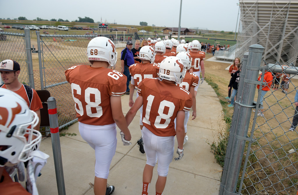 . The Mead football team walks onto their field for their game against Vista PEAK Prep Friday night at Mead High School. To view more photos visit bocopreps.com. Lewis Geyer/Staff Photographer Sept. 08, 2017