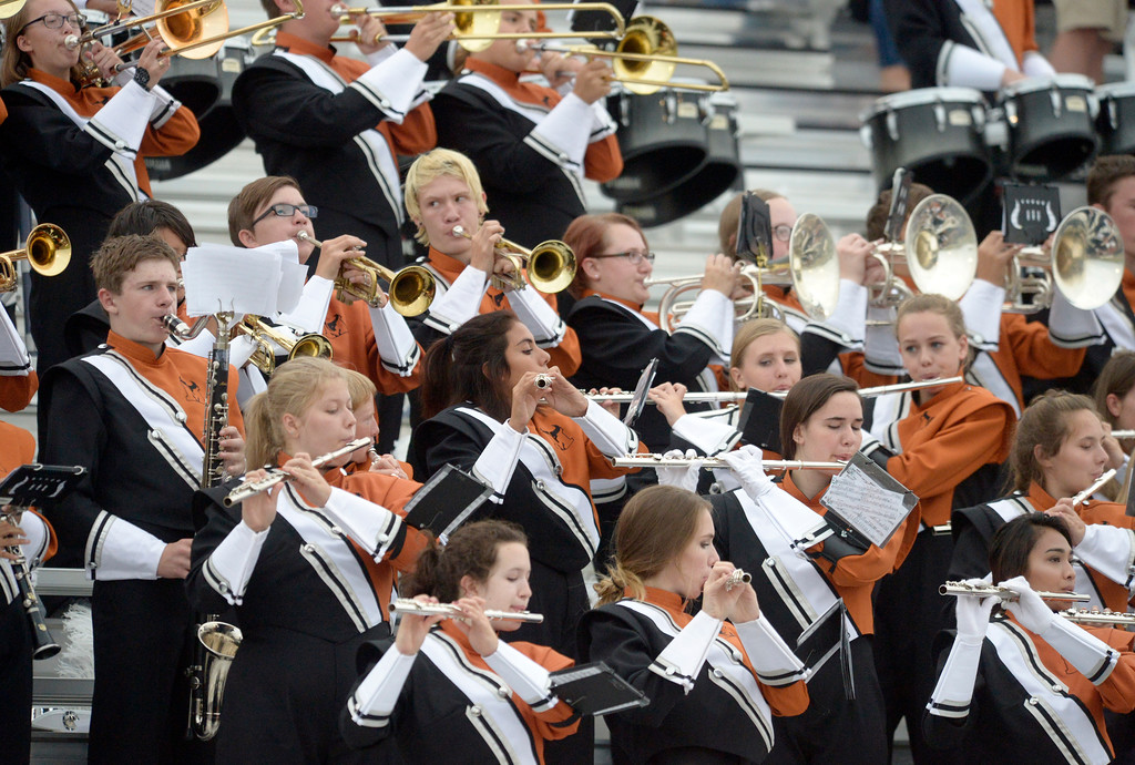 . The Mead High School marching band plays the National Anthem before their team\'s game against Vista PEAK Prep Friday night at Mead High School. To view more photos visit bocopreps.com. Lewis Geyer/Staff Photographer Sept. 08, 2017