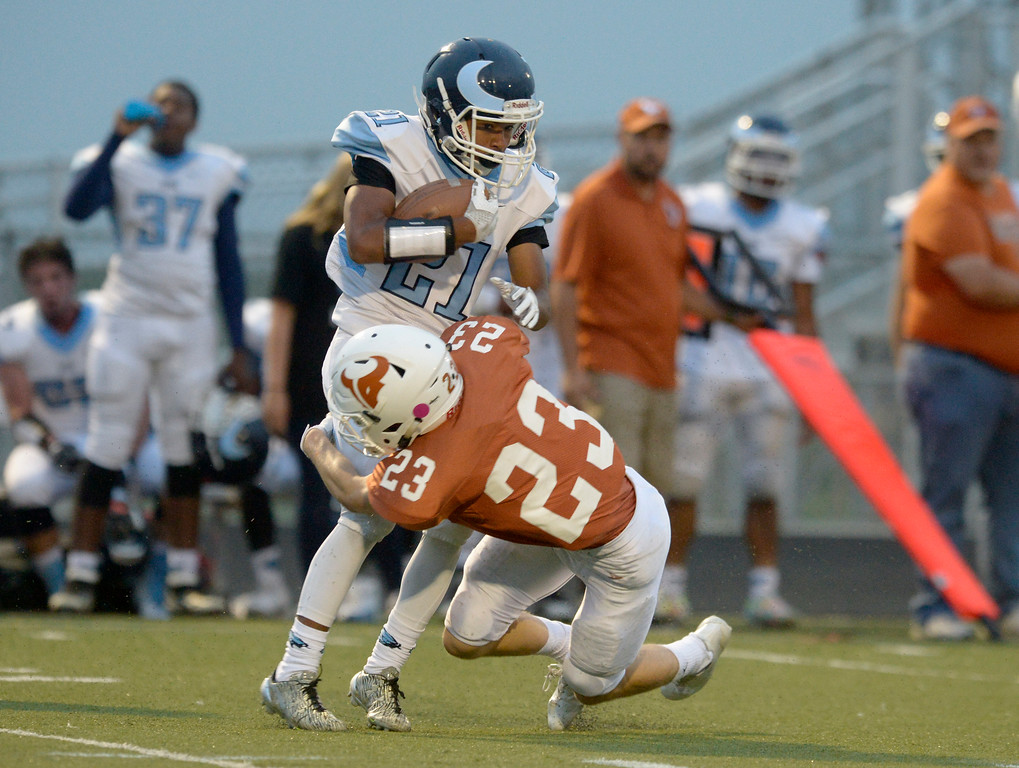 . Mead\'s Jake Wachter tackles Vista PEAK Prep\'s Dennis Flippin in the first quarter Friday night at Mead High School. To view more photos visit bocopreps.com. Lewis Geyer/Staff Photographer Sept. 08, 2017