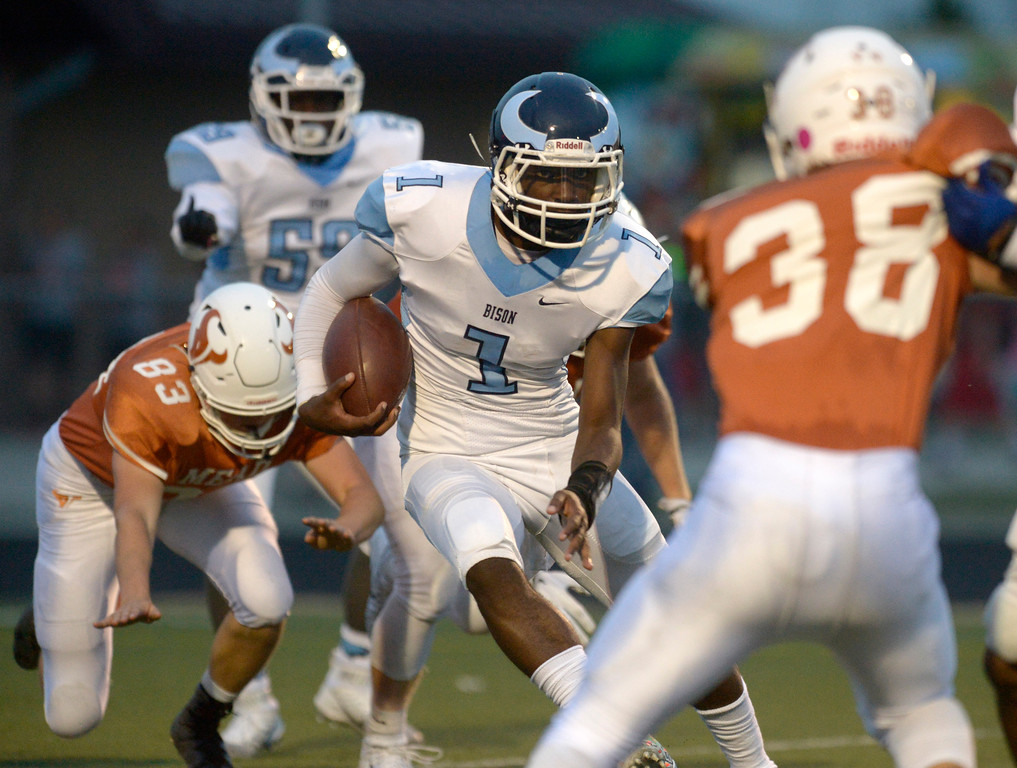 . Vista PEAK Prep\'s Tyrese Bailey looks for an opening against Mead in the first quarter Friday night at Mead High School. To view more photos visit bocopreps.com. Lewis Geyer/Staff Photographer Sept. 08, 2017