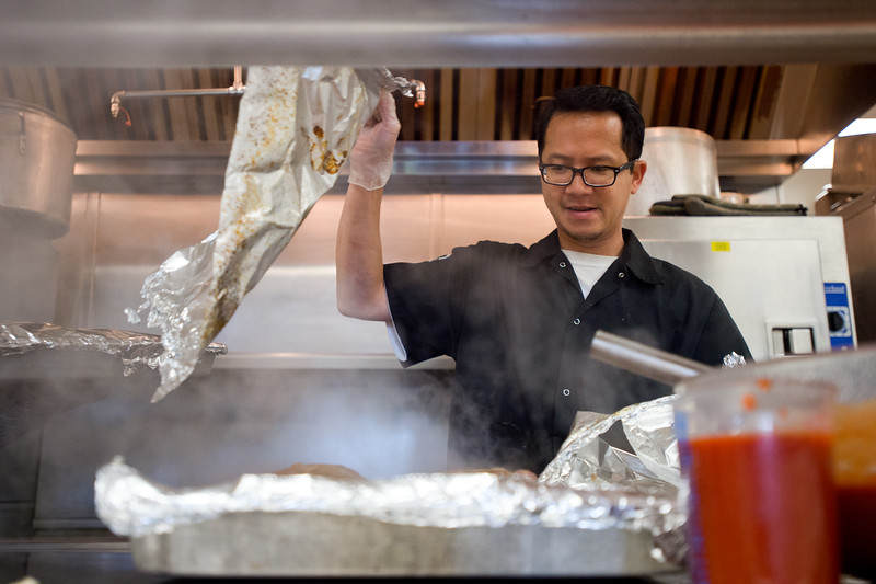 "Anthony Luu, a kitchen assistant, prepares meatloaf for Meals on Wheels at the Broomfield Community Center on Friday. <br /> More photos:  <a href=""http://www.dailycamera.com"">http://www.dailycamera.com</a><br /> (Autumn Parry/Staff Photographer)<br /> July 8, 2016"