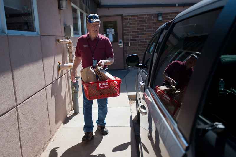 "Ollie Hux, a volunteer, loads food into a van as he prepares for a Meals on Wheels delivery in Broomfield on Friday. <br /> More photos:  <a href=""http://www.dailycamera.com"">http://www.dailycamera.com</a><br /> (Autumn Parry/Staff Photographer)<br /> July 8, 2016"