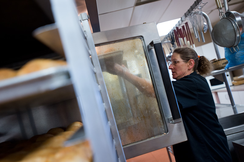 "Myra Harris, a food services technician, puts baked potatoes into the oven while preparing food for Meals on Wheels at the Broomfield Community Center on Friday. <br /> More photos:  <a href=""http://www.dailycamera.com"">http://www.dailycamera.com</a><br /> (Autumn Parry/Staff Photographer)<br /> July 8, 2016"