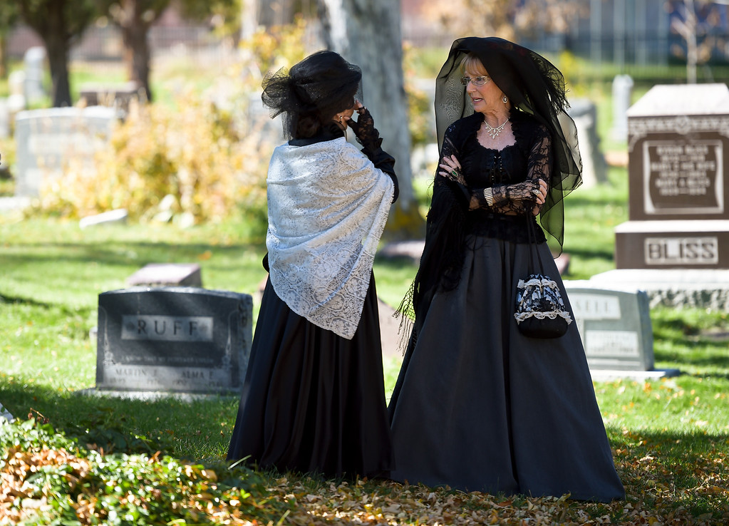 ". BOULDER, CO - OCTOBER 21: ""Legendary Ladies\"" Cheri Enterline, left, and Susan Atwood stand in the shade during Historic Boulder\'s Meet event the Spirits at Columbia Cemetery event Oct. 21, 2018. The cemetery is listed on the State and National Register of Historic Places. (Photo by Lewis Geyer/Staff Photographer)"