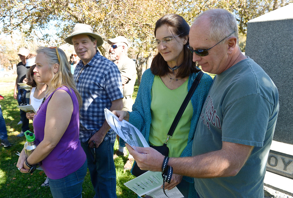 . BOULDER, CO - OCTOBER 21: Rachel Bray and Chris Lawrie look at a photo while listening to a presentation about Eben G. Fine during Historic Boulder\'s Meet the Spirits event at Columbia Cemetery Oct. 21, 2018. Fine was a Boulder pharmacist and photographer. The cemetery is listed on the State and National Register of Historic Places. (Photo by Lewis Geyer/Staff Photographer)