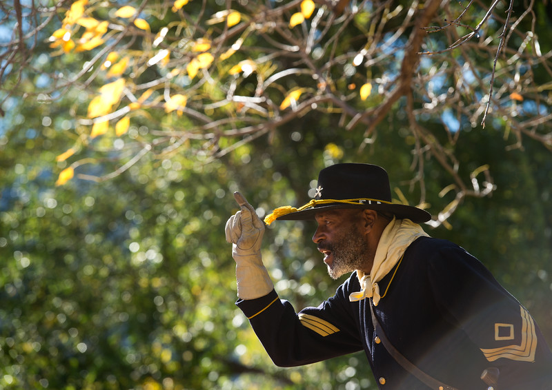 """Fred Applewhite, with the Buffalo Soldiers of the American West, speaks to a crowd of visitors during Meet the Spirits at Columbia Cemetery in Boulder on Sunday. <br /> More photos:  <a href=""""http://www.dailycamera.com"""">http://www.dailycamera.com</a><br /> (Autumn Parry/Staff Photographer)<br /> October 16, 2016"""