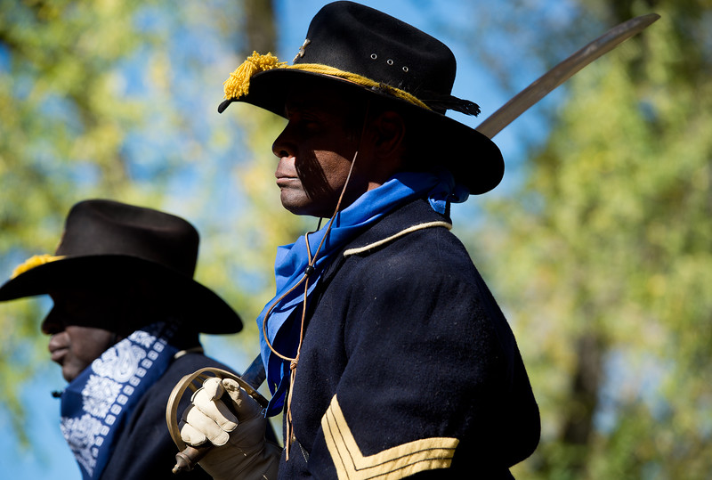 """Tony Johnson, with the Buffalo Soldiers of the American West, pays tribute to Edward Baker, a fallen buffalo soldier, during Meet the Spirits at Columbia Cemetery in Boulder on Sunday. <br /> More photos:  <a href=""""http://www.dailycamera.com"""">http://www.dailycamera.com</a><br /> (Autumn Parry/Staff Photographer)<br /> October 16, 2016"""