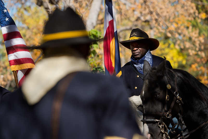 """Kenny Wyatt, with the Buffalo Soldiers of the American West, pays tribute to Edward Baker, a fallen buffalo soldier, during Meet the Spirits at Columbia Cemetery in Boulder on Sunday. <br /> More photos:  <a href=""""http://www.dailycamera.com"""">http://www.dailycamera.com</a><br /> (Autumn Parry/Staff Photographer)<br /> October 16, 2016"""