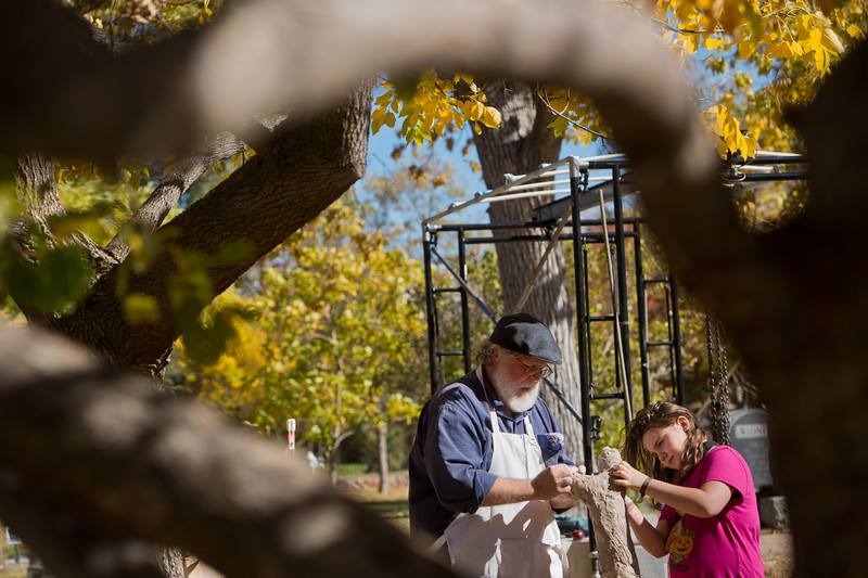 """Scott McKee, who re-enacts Thomas Austin, a Civil War veteran and mason, makes a tree sculpture with Isabelle Ruppel, 9, during Meet the Spirits at Columbia Cemetery in Boulder on Sunday. <br /> More photos:  <a href=""""http://www.dailycamera.com"""">http://www.dailycamera.com</a><br /> (Autumn Parry/Staff Photographer)<br /> October 16, 2016"""