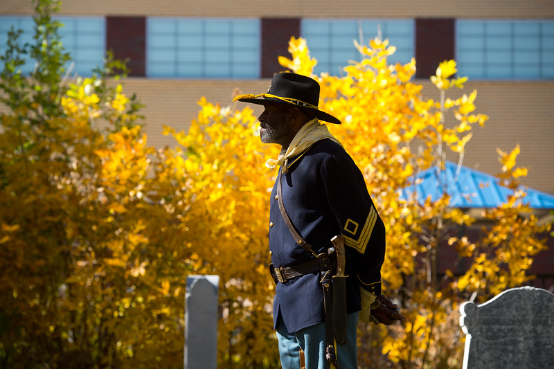 """Fred Applewhite, with the Buffalo Soldiers of the American West, pays tribute to Edward Baker, a fallen buffalo soldier, during Meet the Spirits at Columbia Cemetery in Boulder on Sunday. <br /> More photos:  <a href=""""http://www.dailycamera.com"""">http://www.dailycamera.com</a><br /> (Autumn Parry/Staff Photographer)<br /> October 16, 2016"""