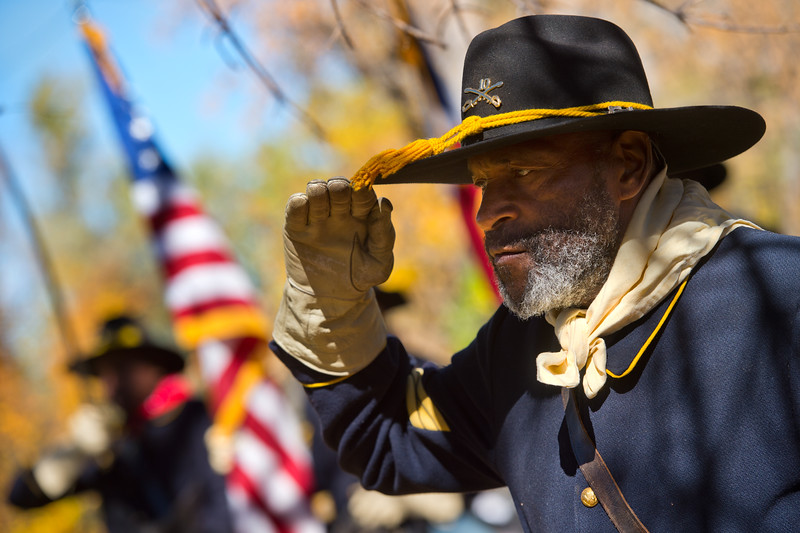"""Fred Applewhite, with the Buffalo Soldiers of the American West, pays tribute to Edward Baker, fallen buffalo soldier, during Meet the Spirits at Columbia Cemetery in Boulder on Sunday. <br /> More photos:  <a href=""""http://www.dailycamera.com"""">http://www.dailycamera.com</a><br /> (Autumn Parry/Staff Photographer)<br /> October 16, 2016"""