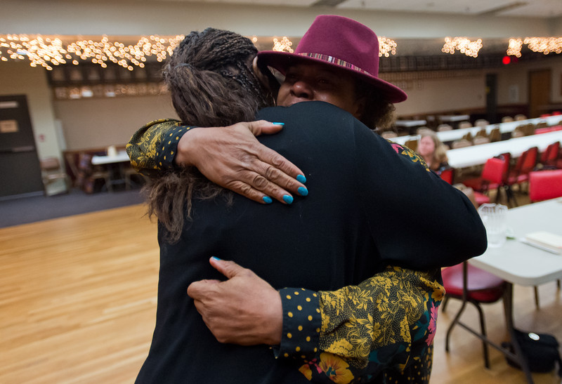 "Wende Harston receives a hug from Peaches Embry during a celebration of life gathering for Austin's brother, Ward Harston, at the Moose Lodge in Longmont on Sunday. Ward, a renowned musician and music teacher in the area, passed away in March.<br /> More photos:  <a href=""http://www.dailycamera.com"">http://www.dailycamera.com</a><br /> Autumn Parry/Staff Photographer<br /> May 15, 2016"