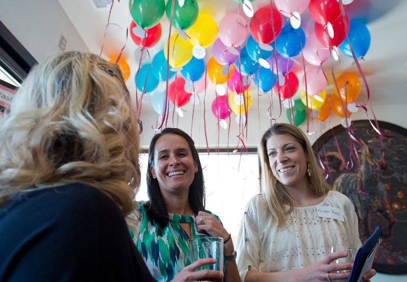 "Erin Pierce and Kristen Reiss converse with a visitor at the balloon raffle during Mesa Elementary's ""Denim and Bling"" Spring Fling fundraiser at Under the Sun in Boulder. Low state funding has increased the school's reliance on fundraising.<br /> More photos:  <a href=""http://www.dailycamera.com"">http://www.dailycamera.com</a><br /> Autumn Parry/Staff Photographer<br /> April 24, 2016"