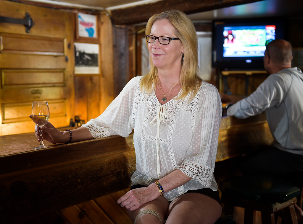 . WARD, CO - SEPTEMBER 13, 2018: Jennifer Kidd has a glass of wine at the Millsite Inn in Ward Sept. 13. The historic restaurant, which opened in the mid-late 1930s, is closing at the end of this month. (Photo by Lewis Geyer/Staff Photographer)